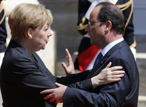 Hollande-y-Merkel-vencedores-de-la-batalla-por-la-paz-de-Normandia
